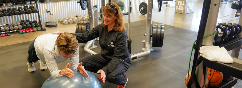 Jacqueline Kelly in gym with client at Kelly Performance & wellness